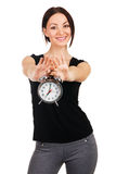 Beautiful young woman with vintage alarm clock Royalty Free Stock Images