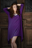 Beautiful young woman with violet dress Stock Photos