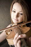Beautiful young woman with violins Royalty Free Stock Images