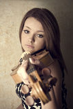 Beautiful young woman with violins Royalty Free Stock Photos
