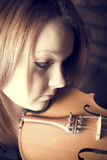 Beautiful young woman with violins Royalty Free Stock Photography