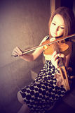 Beautiful young woman with violins Stock Photography