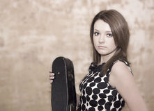 Beautiful young woman with violins Royalty Free Stock Image