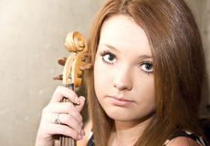 Beautiful young woman with violins Royalty Free Stock Photo