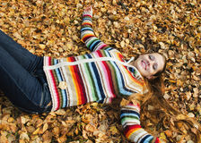 The beautiful young woman on walk in the autumn Stock Photography