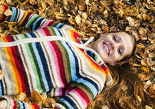 The beautiful young woman on walk in the autumn Stock Photo