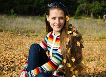 The beautiful young woman on walk in the autumn Royalty Free Stock Image