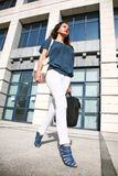 Beautiful young woman walking. With laptop in successful way royalty free stock images