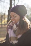 Beautiful young woman walking alone in the park Stock Photo