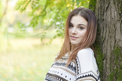 Beautiful young woman walking alone in the park Royalty Free Stock Image