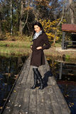 Beautiful young woman walking in autumn park Royalty Free Stock Images