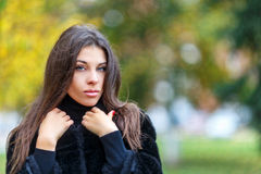 Beautiful young woman walking in autumn park. Autumn fashin concept. Stock Image