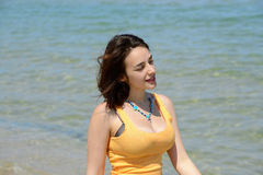 Beautiful young woman walking on the beach Stock Photos