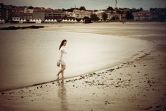 Beautiful young woman walking in a beach Royalty Free Stock Images