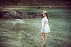 Beautiful young woman walking in a beach Stock Images
