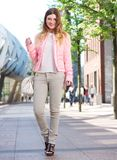 Beautiful young woman walking in the city with bag Royalty Free Stock Photos