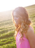 Beautiful young woman walking in the countryside Royalty Free Stock Photography
