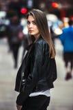 Beautiful young woman walking on the crowdy street Stock Photo