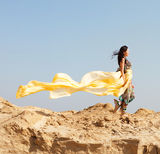 Young woman walking in a desert Stock Photos