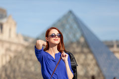 Beautiful young woman walking near the Louvre Royalty Free Stock Images