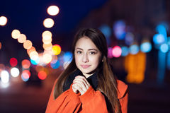Beautiful young woman walking in the night city Stock Photography