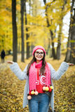 Beautiful young woman walking outdoors in autumn Stock Photography