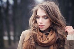 Beautiful young woman walking in park. Female model face royalty free stock image