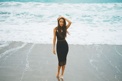 Beautiful young woman walking at the sea Stock Photography