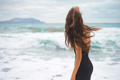 Beautiful young woman walking at the sea Royalty Free Stock Photos
