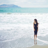 Beautiful young woman walking at the sea Royalty Free Stock Images