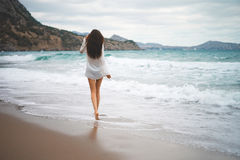 Beautiful young woman walking at the sea Stock Photos