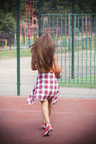 Beautiful young woman walking on the sports ground Stock Photos