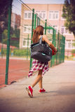 Beautiful young woman walking on the sports ground Stock Photography