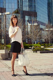 Beautiful young woman walking on the street Royalty Free Stock Image