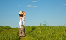 Beautiful young woman walking with a suitcase Stock Photography