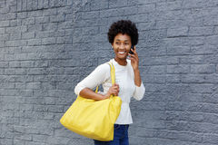 Beautiful young woman walking and talking on cellphone Stock Photography