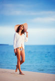 Beautiful young woman walking on tropical beach Royalty Free Stock Photo