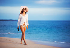 Beautiful young woman walking on tropical beach Stock Photography