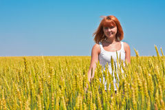 Beautiful young woman walking at wheat field Royalty Free Stock Photo