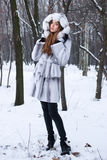 Beautiful young woman walking  in winter forest Royalty Free Stock Image