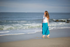 Free Beautiful Young Woman Walks Along The Ocean Royalty Free Stock Photography - 20926817
