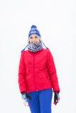 Beautiful young woman in warm clothing walking outdoors Stock Photo