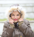 Beautiful young woman in warm soft clothes outdoor in a winter day Royalty Free Stock Photos