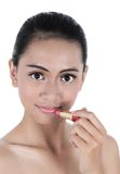 Beautiful young woman was using lipstick Stock Photo