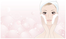 Beautiful young woman washing her face Royalty Free Stock Photos