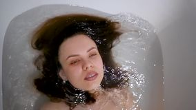 Beautiful young woman washing her hair in bath. Beautiful young woman washing her hair stock video