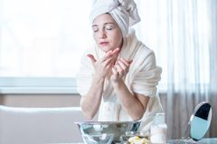 Beautiful young woman washing and refreshing face with water in the morning. Concept of hygiene and care for the skin stock images