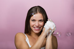 Beautiful young woman washing up her face Stock Photos