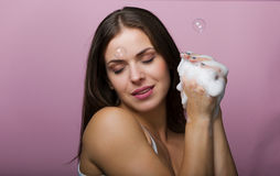 Beautiful young woman washing up her face Royalty Free Stock Photo