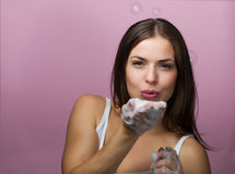 Beautiful young woman washing up her face Stock Photography